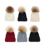 Зимна дамска шапка с помпон от естествен косъм